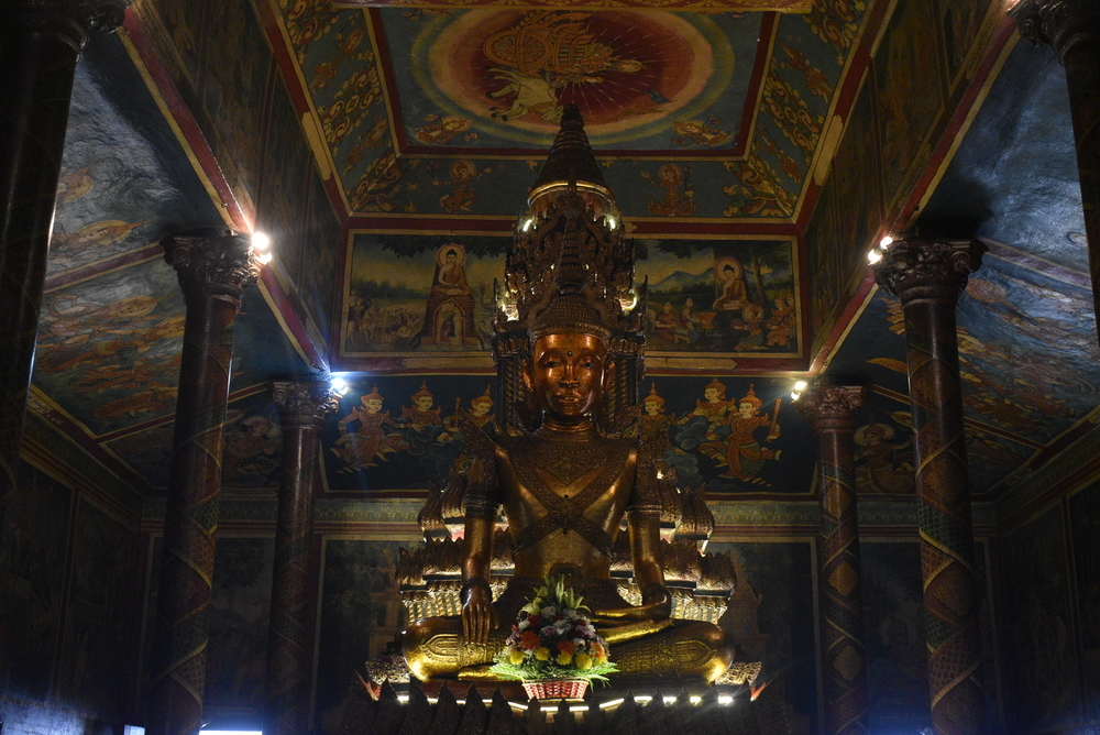 A golden Buddha statue dominating the pagoda interior.