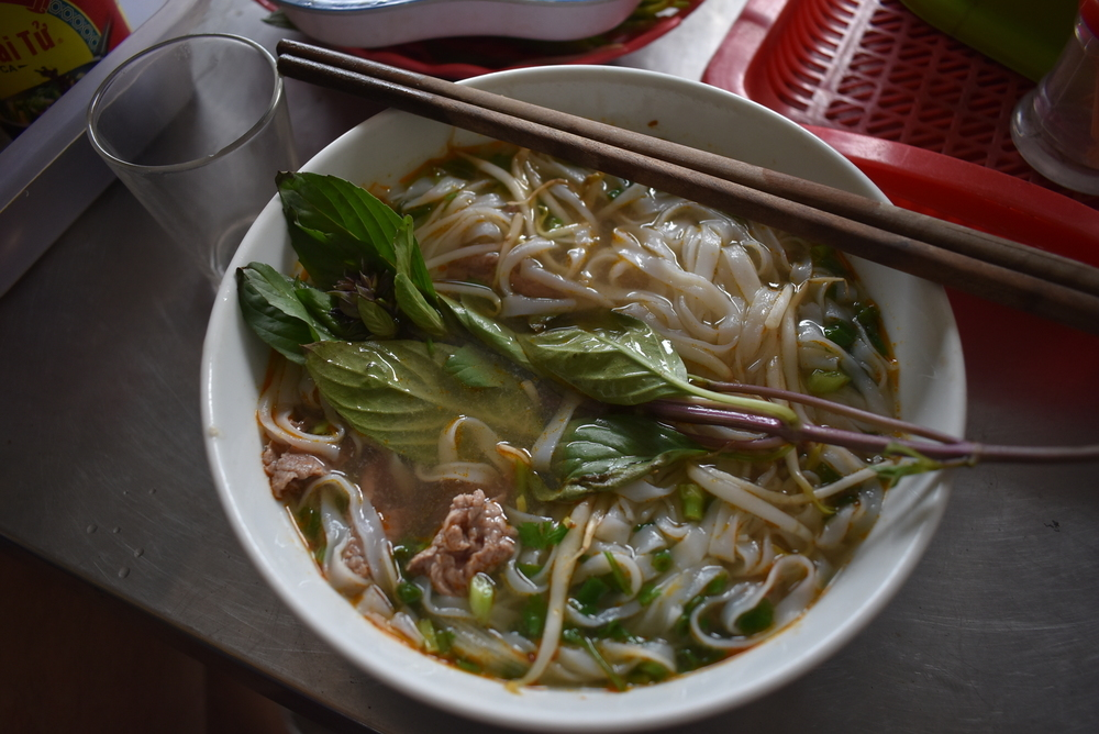 This is Pho Bo, a rice noodle soup with beef.