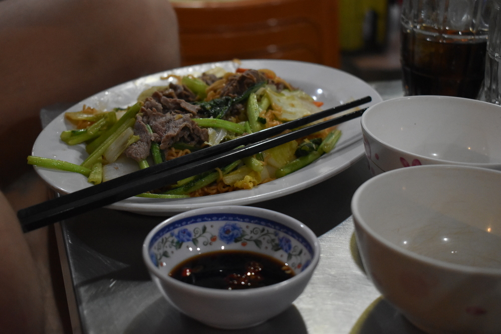 Mi Xao Bo is a fried rice noodle dish with lots of vegetables and beef meat.
