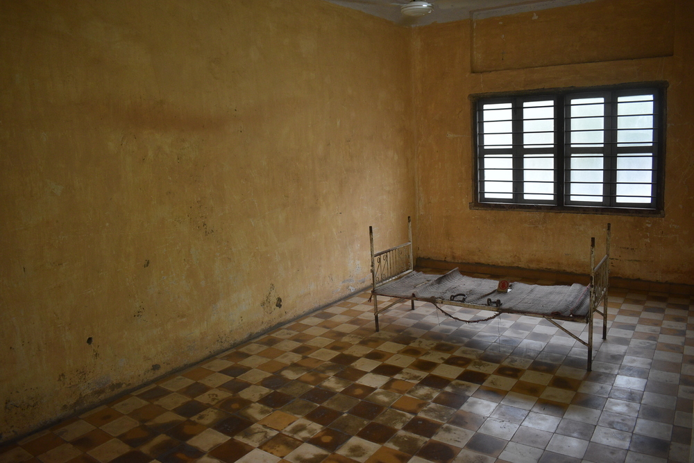 The first section of Tuol Sleng is full of haunting rooms where the prisoners were tied to their beds.