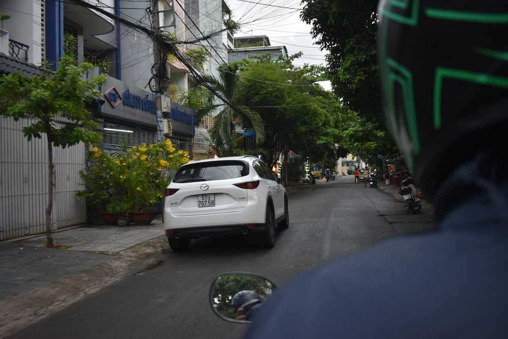 Riding around alleys in Saigon. Sometimes you feel like a small ant in the heavy traffic in Saigon.