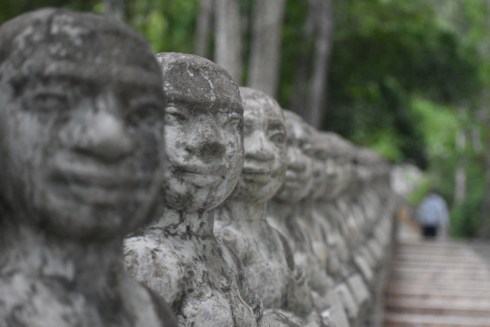 Numerous mystic statues will follow you on the way to the top of the hill.
