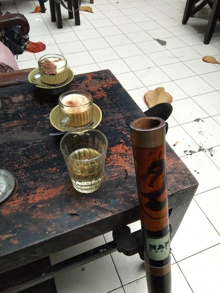 Enjoying egg coffee and Thuoc Lao