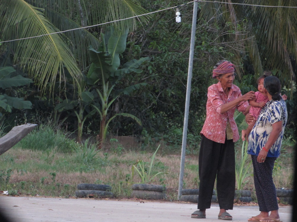 Cambodian locals strolling on the highway.