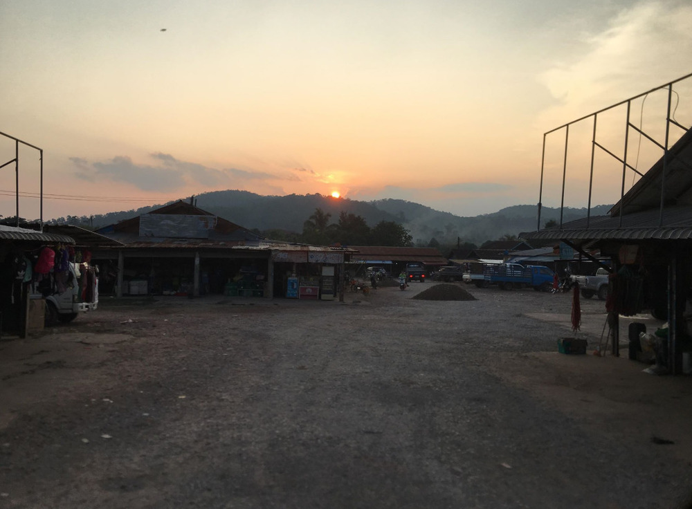Sunset over a small local market.