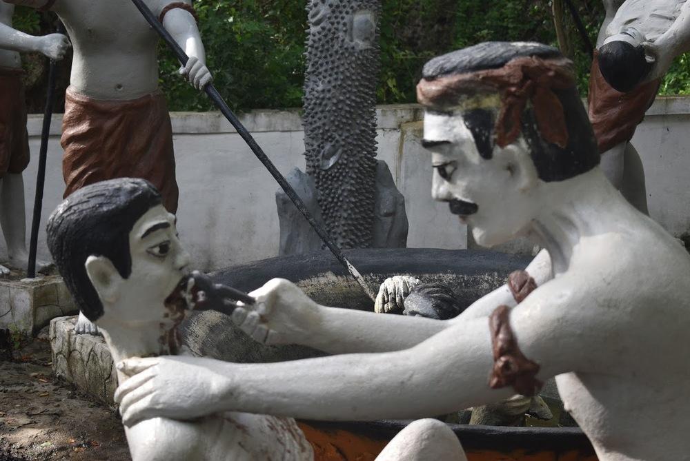 Statues depicting Khmer Rouge torture methods.