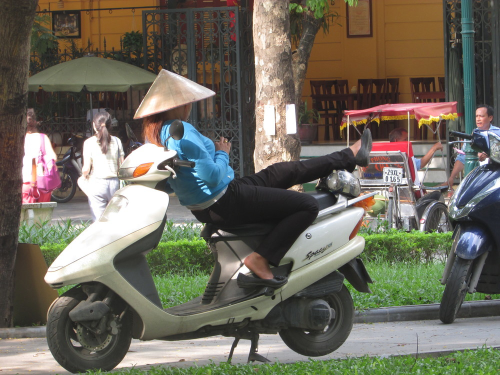 Woman sleeping on the motorbike