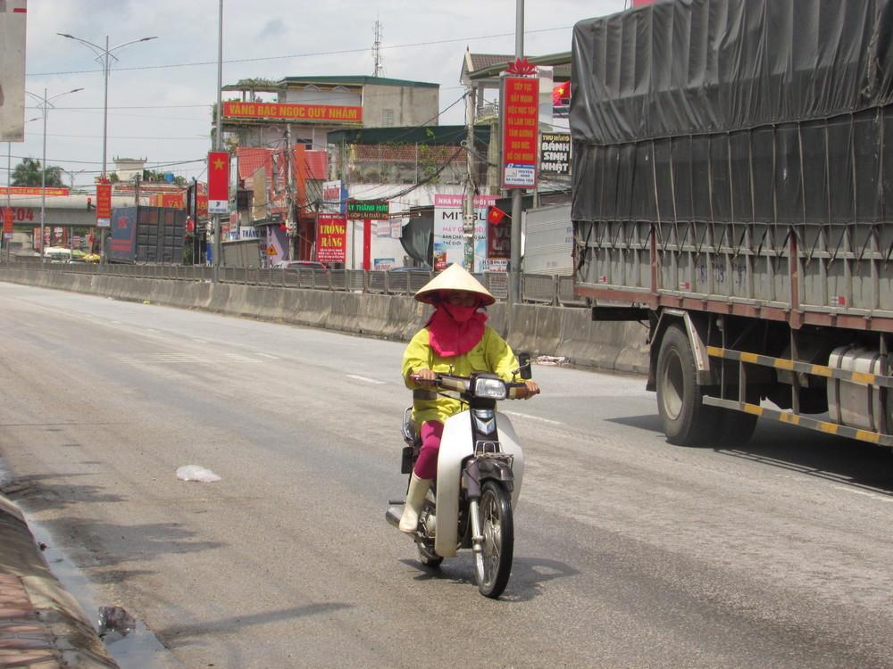 A hardworking woman in traffic