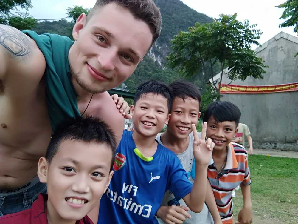 Playing football with countryside kids