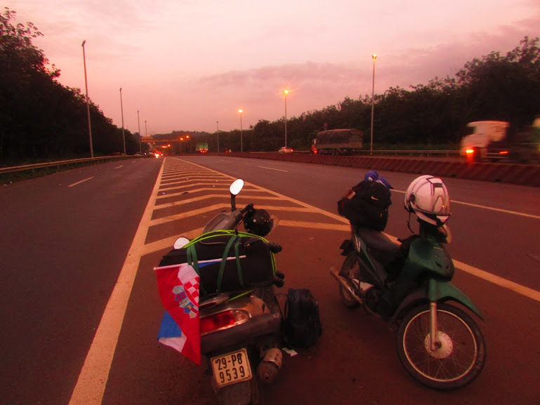 Waiting for the third biker on the intersection before Saigon.