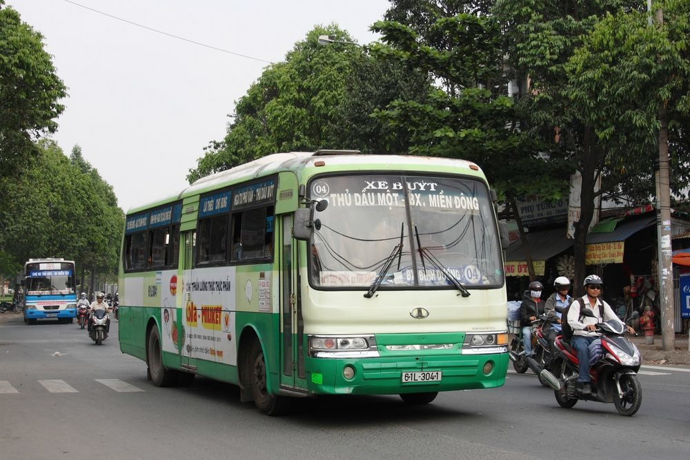The local bus in Saigon is easily spotted by its white and green color.