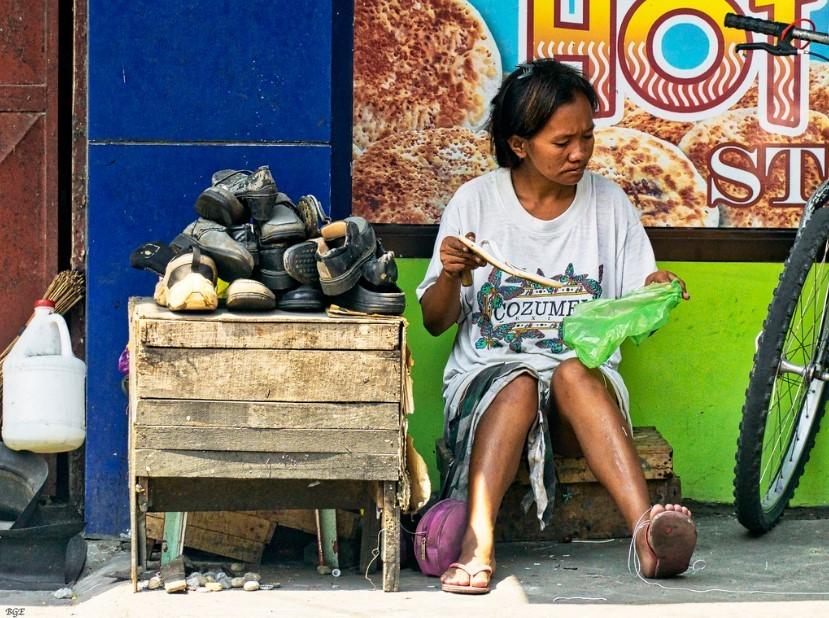 Shoe repair lady waiting for customers