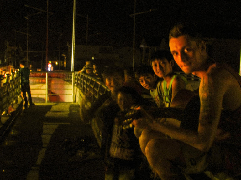 Busking on the QL1A overpass with curious children!