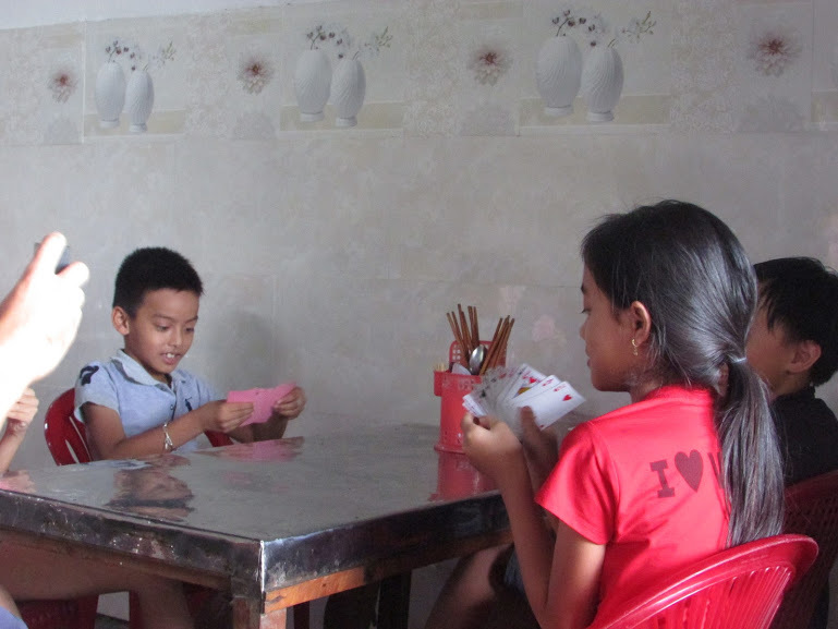 Local kids playing cards.